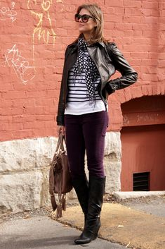 Jessica from What I Wore - striped sweater, polka dot scarf, leather jacket and boots, and purple cords.