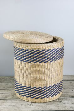Handwoven ssquare storage baskets//Rustic Home Decor / green furniture/ straw basket Handwoven round storage basket These round baskets are 100% handmade from cattails with a strong wooden structure inside and featuring blue strips at the top and bottom. It is ideal for storing odds and ends around the house. This basket features a locally woven coarse cloth on the inside, which has exceptional air permeability, and is connected by hook-and-loop tape to the basket, making ...