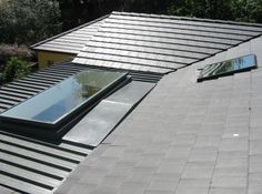 """""""Roof windows"""" is Aussie speak for """"skylights."""" The concept is still the same. Put a sheet of glass across a hole in the roof to let some more light in for free. Do most homes with these features begin that way, or are they installed after construction? Skylight Shade, Skylight Window, Roof Window, Side Window, Window Manufacturers, Sun Roof, Roof Lines, Tree Canopy, Glass Roof"""