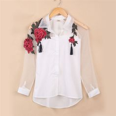 Go out and set a new trend with this stylish and pretty embroidered shirt with turn down collar. Set a new style girl!! Details: - Tops - Floral - Embroidery - Turn down collar - Vintage - Smart - Fab