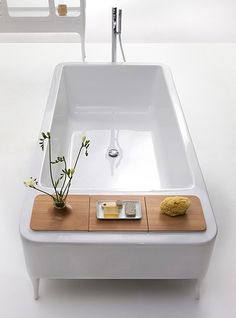 I'm always reading or using an ipad in the tub so this would be perfect! I love lighting white candles or placing a boquet of wildflowers near by. This designer got it right. #tub #table