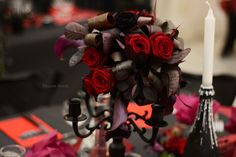 flower decoration for a gothic wedding in red and black
