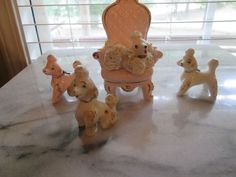 vtg. porcelain poodle one has lace trim in gold hand painted made in Japan