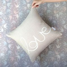 Natural linen cushion cover with LOVE print in white - hardtofind.