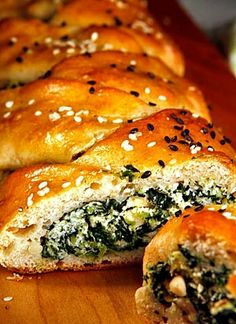 Spinach and Ricotta Stuffed Challah ✡  2 (10-oz) pkgs frozen chopped spinach (defrosted), 1½ tsp oregano, ½ tsp thyme, ½ cup chopped fresh basil eaves (~20 leaves), 1-4 pressed garlic cloves, ⅓ cup pine nuts (toasted in a dry frying pan), 2 cups ricotta cheese, ¼ cup cornmeal or flour, salt & freshly ground black pepper