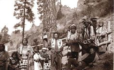 Salish at Bitterroot Medicine Tree. Adele Vanderburg, Harriet Adams, Mary Kaltomee (Sackwoman), Ateline Joscum, Chief Martin Charlo, Eneas Finley, Victor Vanderburg, Rose Marengo. On the ground: Louis Pellew.