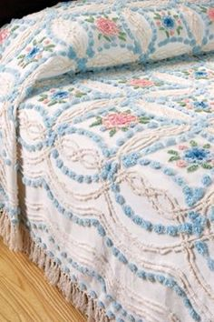 I remember sleeping with a chenille bedspread when I was little...I want one now!