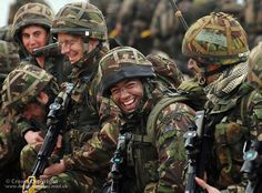 A Royal Marine of 42 Commando jokes with comrades during Exercise South West Sword in the Solent, England. Cheerfulness Through Adversity is one of the qualities required to become a Royal Marine.