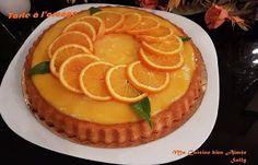 Une recette préparée par Sally, une tarte à l'orange rapide et facile à faire, une crème d'orange sur un fond de génoise légère au yaourt.