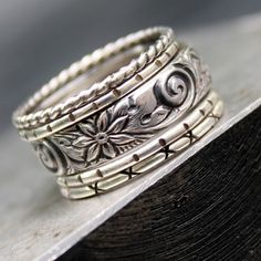 A collection of five sterling silver bands. Four skinny bands with handmade detailing and one 5mm wide band with beautiful flower and swirl details. Mix them up - wear them separate - a new look for everyday! All sterling silver has been oxidized and polished. Please note that due to the width (around 11mm) of the band I recommend to order 1/2 size larger than your regular ring size. These rings are made to order, so please leave your size in the note to seller section and allow up to 10...