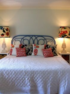 leave the walls blue, white bedspread, paint the headboard, and get lots of fun pillows