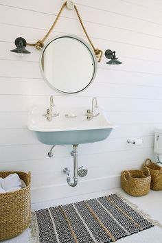 Cottage Bathroom Boasts A Turquoise Trough Sink, Kohler Brockway Sink,  Fitted With Two Gooseneck Faucets And A Rope Captainu0026 Mirror Lining A  Shiplap Wall ...
