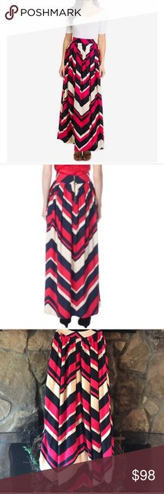 "🌺ELIZABETH McKAY🌺SILK MAXI CHEVRON SKIRT🌺 Stunning piece by Elizabeth McKay RETAIL $239.  100% silk back exposed zipper with top button gathered to flatter your figure fully lined  Lining 100% polyester.  Wear with heels as seen in photo or with flats and a T-shirt super cute either way!!Colors include pink and navy. Waist 12 1/2"" length 40 1/2""🌺ELIZABETH McKAY🌺SILK MAXI CHEVRON SKIRT🌺 Elizabeth McKay Skirts Maxi"