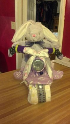 Front view of diaper motorcycle. I love the bottle bottom as a headlight!
