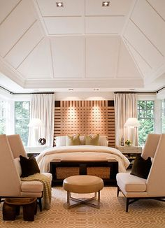 amazing bedroom... the ceiling, the recessed lighting above the bed and the matching loveseats!
