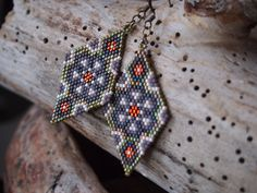 SALE was $28 now $23 here is another cool design by Anna Belous that i followed, and that you can find here: http://www.anabel-beadpatterns.com/2012/11/peyote-earrings-patterns.html different colors and finishes of neat little Delica seed beads that i love to work with so much create an