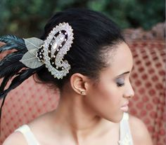 The first member of the Dalmatian Collection, this striking beaded feather fascinator exudes power and grace.    Glimmering gold and winking jewels