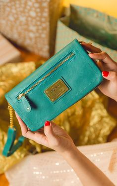 The best gifts come in smaller sizes.  Love this Nicole Miller crossbody wallet!