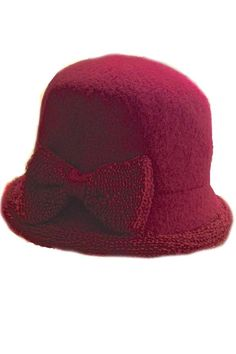 Knit Wool blend hat with a large bow on the the side in color Rubi. Keep your head warm in this stylish hat, wear it with casual or a dressy outfit.   Wool Knit Hat by Santacana Madrid. Accessories - Hats and Gloves Portland, Oregon
