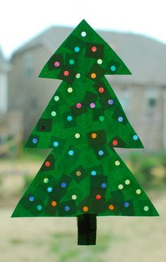 Lighted Christmas tree craft - cut the tree from construction paper, punch holes in it, tape different colors of tissue paper behind each hole, hang in the window so the light can shine through the holes and make the tissue paper glow.