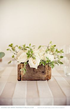 Pretty white roses in a rustic wooden box as centerpiece #rustic #chic #centerpiece #wood #wedding