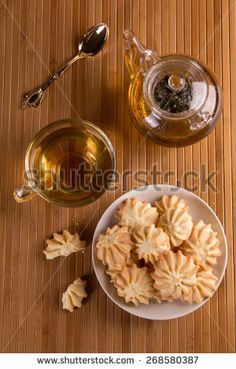Fresh delicious cookies and tea on the table - stock photo