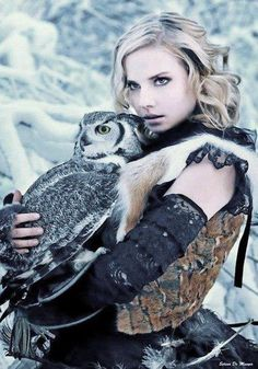 Whatever, whimsical lady-snuggling-an-owl. I should be the one holding that owl. What an cool photo.