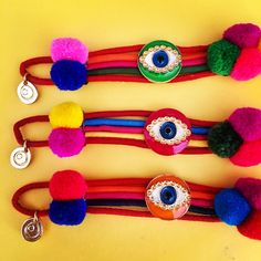 #eyespy with my lil' eye something beginning with P  #danalevy neon evil eye lucky charm pompom bracelets will add a pop of colour to your week