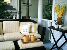 Front Porch With Black Wicker Furniture and Yellow Accents
