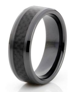 The Black Carbon has the black on black effect. This high polished black plated tungsten carbide ring has the unique black carbon fiber inlay down the center.
