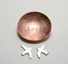 """Tiny Love Birds Bowl: Hammered Finish, stamped with the word """"love""""; part of the Etsy shop """"Help the Gulf Coast"""" where artists have donated wares so that all proceeds help the Gulf Coast"""