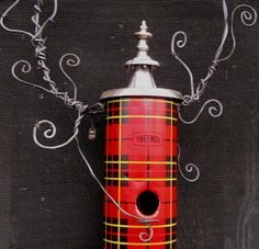 Whimsical plaid birdhouse.