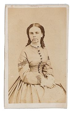 A cdv portrait of Olive Oatman, with Powelson's Rochester, NY imprint on verso. Oatman (1837-1903) was captured by the Yavapai in Arizona at the age of 13 and was then sold to the Mojave. She was tattooed on her chin, marking her as a slave. She was ransomed at Fort Yuma in 1856, and thereafter lived the rest of her life in California and New York.