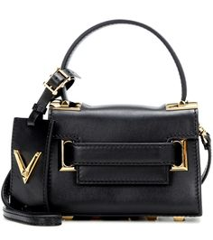 Valentino - My Rockstud Mini leather shoulder bag - Valentino offers their take on the mini bag trend with this downsized shoulder bag. The black leather piece is finished with the brand's signature gold-tone pyramid studs, which give it its luxe status. Carry it in your hand after dark or over your shoulder for busy days in the city. seen @ www.mytheresa.com
