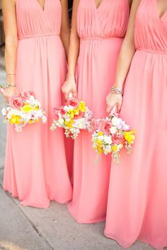 I love the style of these bridesmaids dresses. Could easily have them shortened for more casual wear after the wedding.