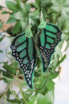 Hey, I found this really awesome Etsy listing at https://www.etsy.com/listing/159888554/fairy-wings-earrings-green-iridescent