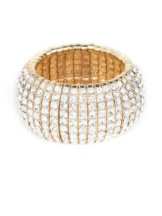 Delight in the drama of this spectacular crystal cuff.  Cast in classic gold, the endless rows of crystals add the perfect amount of flash to help you make a statement.  This is part of the ELLE Holiday Shop