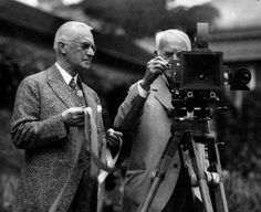 George Eastman, the founder of modern photography, and Thomas A. Edison, inventor of the motion picture camera, talk in the Eastman House gardens in Rochester in 1928. Nearly four decades earlier, Eastman had supplied the first strip of film for Edisons experiment.