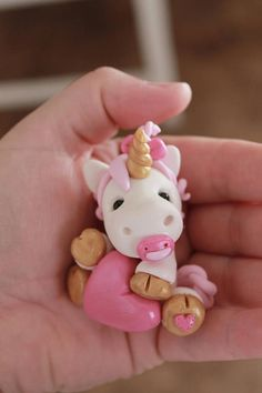 This listing is for one hand sculpted polymer clay baby unicorn. This adorable little baby unicorn sits a mere 2 tall (other sizes available, PM for details) and would look adorable atop a small baby shower cake. Her hair is formed into tiny ringlets and a tuft of hair is gathered at the