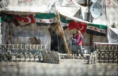 Two Syrian refugees giving me the peace sign outside their tents as Bohsin camp, 2012.