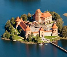 """Trakai Island Castle,  Trakai, on an island in Lake Galve, Lithuania....    www.castlesandmanorhouses.com    ....    The castle is sometimes referred to as """"Little Marienburg"""". Trakai was one of the main centres of the Grand Duchy of Lithuania for which the castle held great strategic importance."""