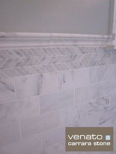 love the little bit of trim.  $7SF Carrara Marble Subway Tile - traditional - spaces - new york - The Builder Depot