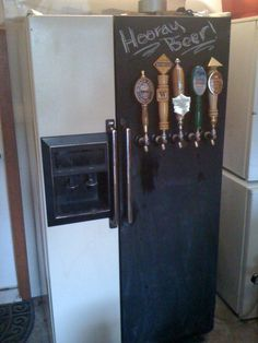 Painting Lance's kegerator fridge with chalkboard paint. Awesome.