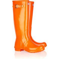 Bright orange boots make a rainy day brighter