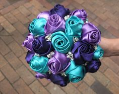 Like this put with white or silver instead of the dark blue and more broaches! Etsy-Handmade Ribbon Rose Bouquet- Purple & Teal Flower accented with rhinestone (Large, 8-9 inch)