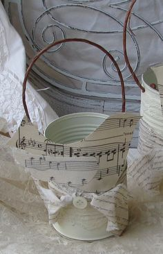 """""""DIY party favor or decor""""    Not the music notes. I like the can and paper string idea. Savvy and cute!"""