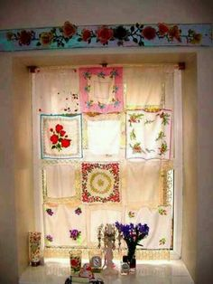 Whimsical window covering made from vintage hankerchiefs.