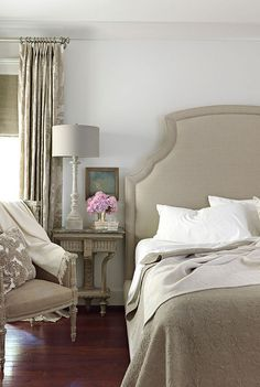 Traditional gray bedroom: Benjamin Moore 'Revere Pewter'    In this Alabama house, interior designers Paige Schnell and Doug Davis of Tracery Interiors painted walls Benjamin Moore's Revere Pewter, a lovely pale gray that provides a nice contrast with the dark floors. The Bernhardt bed in natural linen is from Three Sheets. House Beautiful.