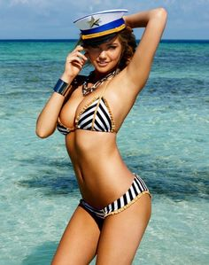 5c77fbc133 Low-rise black and white striped brazilian bottom with gold lurex ruffle  trim and piping detail by Beach Bunny Swimwear