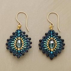 "Bursts of blue goldstone emanate from golden Miyuki beads and an ""eye"" of green quartz, evoking a peacock's plumage. Handmade in USA by Miguel Ases. 14kt goldfill French wires. 1-5/8""L"